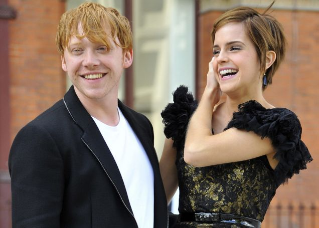 British Actors Rupert Grint And Emma Watson Who Play Ron Weasley And Hermione In The Harry Potter Series Of Films Pose For Photographers In London